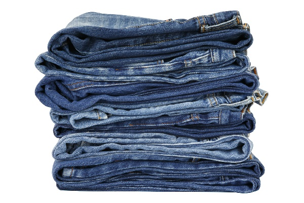 lot of blue jeans isolated on white background
