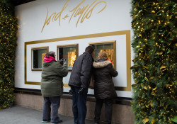 People viewing the Lord and Taylor Department Store Christmas window display in midtown Manhattan.  During the holidays, over 250,000 people pass by the Lord&Taylor windows daily.